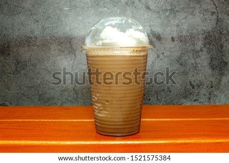 A picture of ice blended mocha on the table  #1521575384