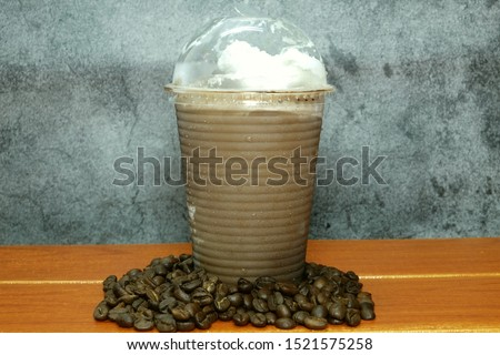 A picture of ice blended mocha with coffee beans on the table  #1521575258