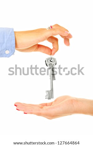 A picture of keys being given from hand to the other over white background