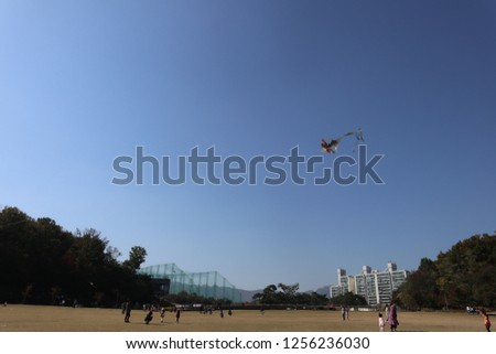 a picture of kite-flying #1256236030