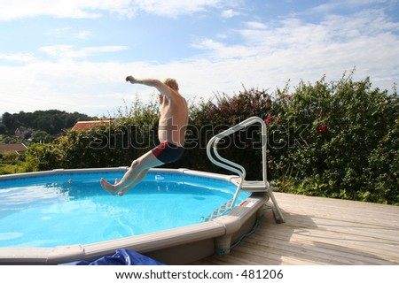 A picture of my dad jumping in the pool at home