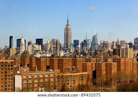 A picture of New York City, NY, USA, featuring the skyline of midtown with the famous Empire State Building in the center.