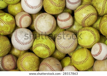 a picture of old softballs and baseballs