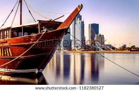 A picture of one of the marinas in the Sharjah City in UAE, where overlooking the towers on the sea at sunset. An exquisite view of architectural and civilization development.
