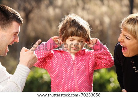 A picture of parents shouting at a little girl in the park