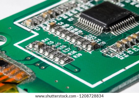 A picture of printing circuit board with chip resistor and microchip of an electronic product.