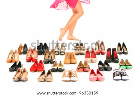 A picture of sexy female legs among shoes over white background #96350159