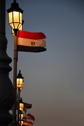 A picture of the flag of Egypt on one of the pillars of the lighting in one of the famous bridges in the Alexandria city