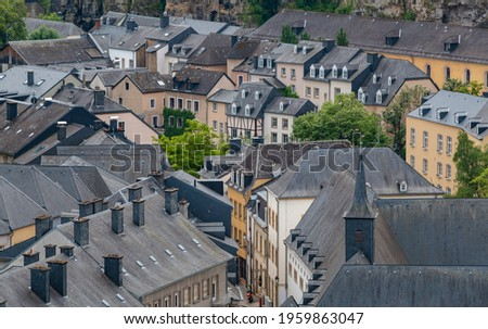 A picture of the gray rooftops and architecture style of the Grund district of Luxembourg. Stock photo ©