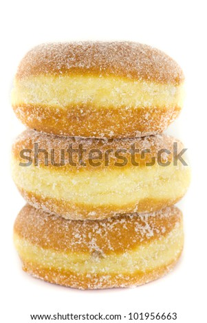 A picture of three jelly donuts stacked on top of each other