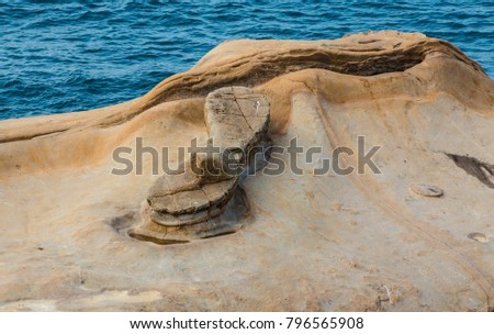 A picture of Yehliu's famous Fairy's Shoe Rock which belongs to the ginger rock category. It was formed due to seawater erosion on rock layer that contains rocks of different hardness. #796565908