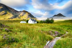 A picture postcard cottage at Glencoe in the Scottish Highlands