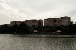 A picture with noise effect of Putrajaya lake during sunset with government building insight.