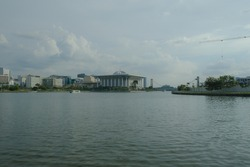 A picture with noise effect of Putrajaya lake with several landmark including Masjid Sultan Mizan insight.