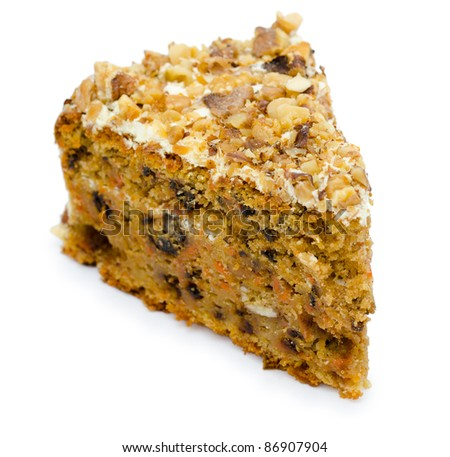 a piece of a cake with raisins, dried apricots and walnuts, macro