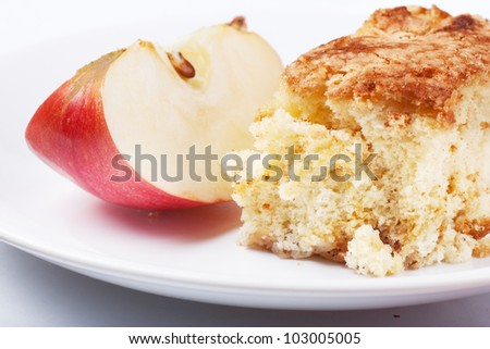 A piece of apple pie on a white plate