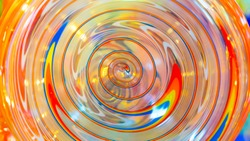 A piece of bright colorful glass with spiral structure