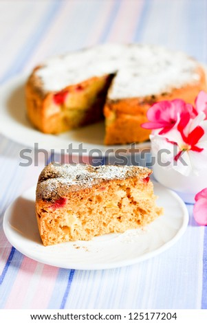 A piece of cake and pie with apples decorated with flowers