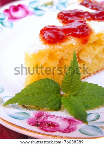 A piece of cake on a plate with green leave