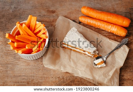 A piece of carrot cake. Carrot cake. A healthy dessert without gluten, no sugar and milk.chatty carrots and sliced. Useful snack, carrot snacks. Dessert on coconut milk from carrots.