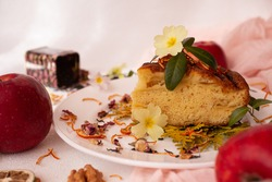 A piece of Charlotte apple pie decorated with flowers