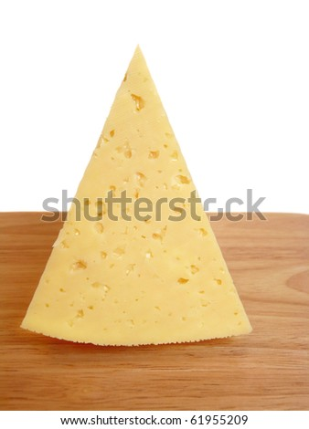 A piece of cheese on a cutting board. Isolation