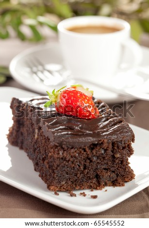 a piece of chocolate cake with coffee - stock photo