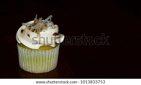 A piece of cup cake for birthday with black ground #1013833753