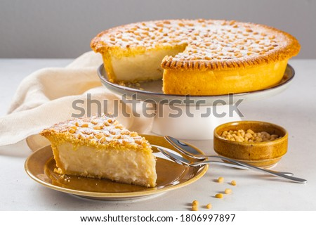 A piece of Custard cream cake with pine nuts. Traditional italian cake - torta della nonna or grandmother's cake. Tuscany pastry.