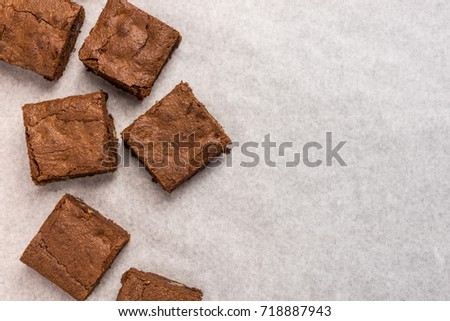 a piece of homemade chocolate brownies on white background.