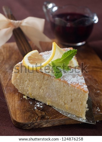 A piece of lemon cake with mint decoration, selective focus, shallow DOF