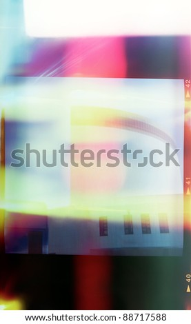 A piece of medium format film with colorful abstract filling in frame, good for background