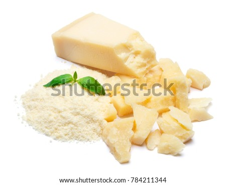 a piece of Parmesan and grated cheese on white background