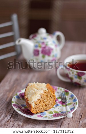 A piece of pumpkin cake with cream cheese