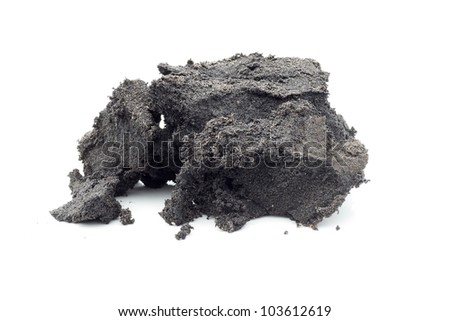 A piece of raw bitumen or oilsand / tarsand on white.