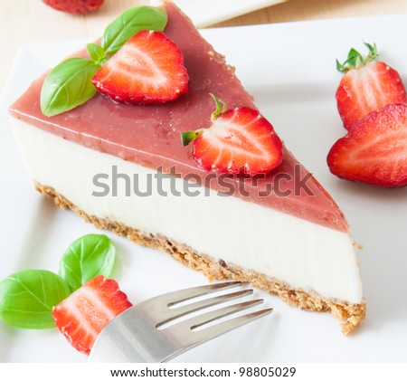 a piece of strawberry cheesecake on white tray with coffee cup - stock photo