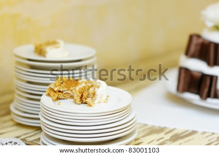 stock photo A piece of white and brown wedding cake