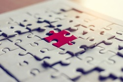 A pieces of jigsaw puzzle will be matching. Business concept. Red and white puzzles.