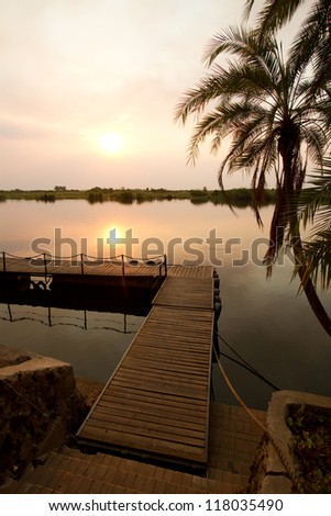 A pier at sunset on the Chobe River, Botswana