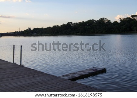 A pier in Paranoa Lake, Brasilia, Brazil, artificial lake formed by the dammed waters of the Paranoa River. Amazing look with recreational options like boating, SUP and other water activities