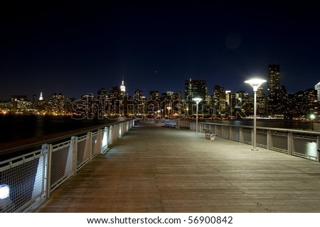 A pier overlooking midtown Manhattan including the Empire State Building