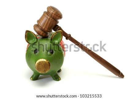 A pig bank and a mallet represent legal expense concepts.