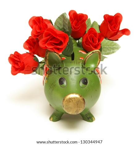 A pig bank and red roses represent the love of money.