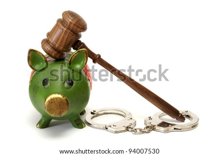 A pig bank, handcuffs, and a mallet represent legal expense concepts.