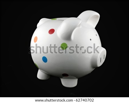 A piggy bank isolated against a black background