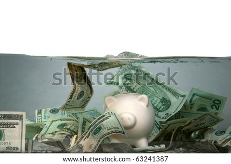 a piggy bank sinks in dark murkey water, representing the idea of drowning in debt, or keeping your head above water and other financial concepts