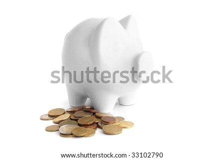 A piggy bank standing next to some money. All isolated on white background. #33102790