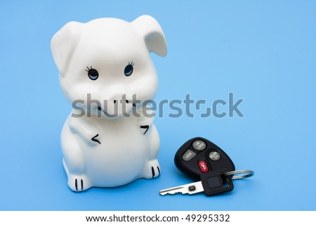 A piggy bank with a set of car keys on a blue background, Financing your car