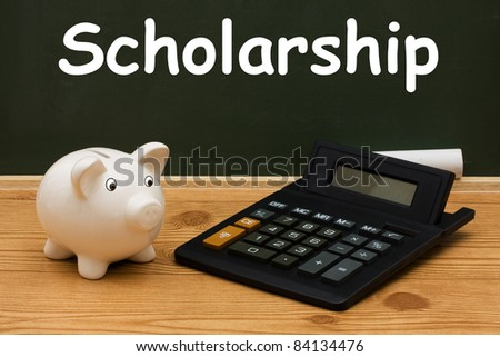 A piggy bank with calculator and chalk on a chalkboard with word Scholarship, Education Scholarship