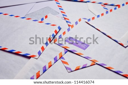 A pile of airmail envelopes